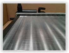 Closeup of metal fins on a car radiator